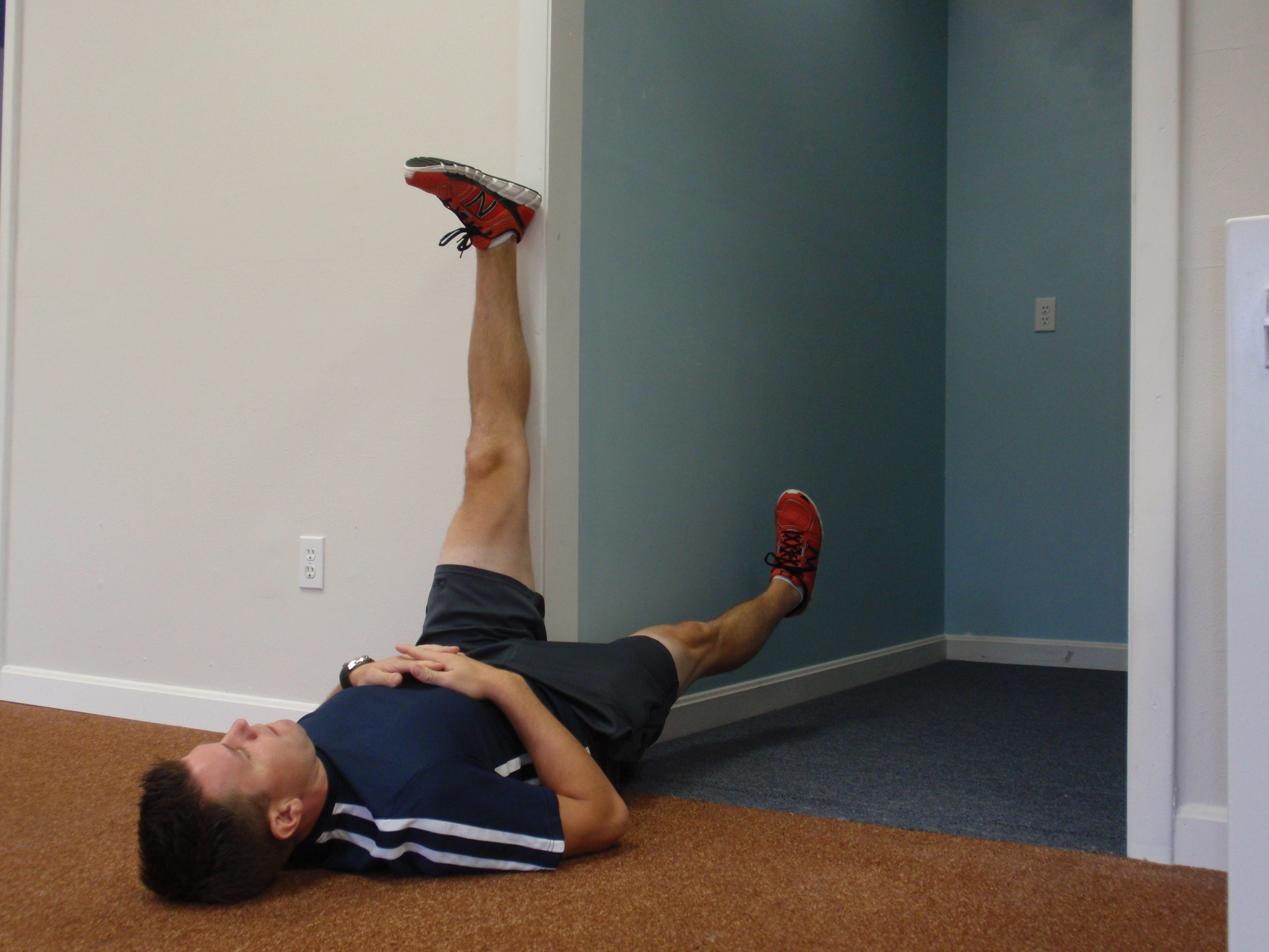 How to Do a Wall Hamstring Stretch pics