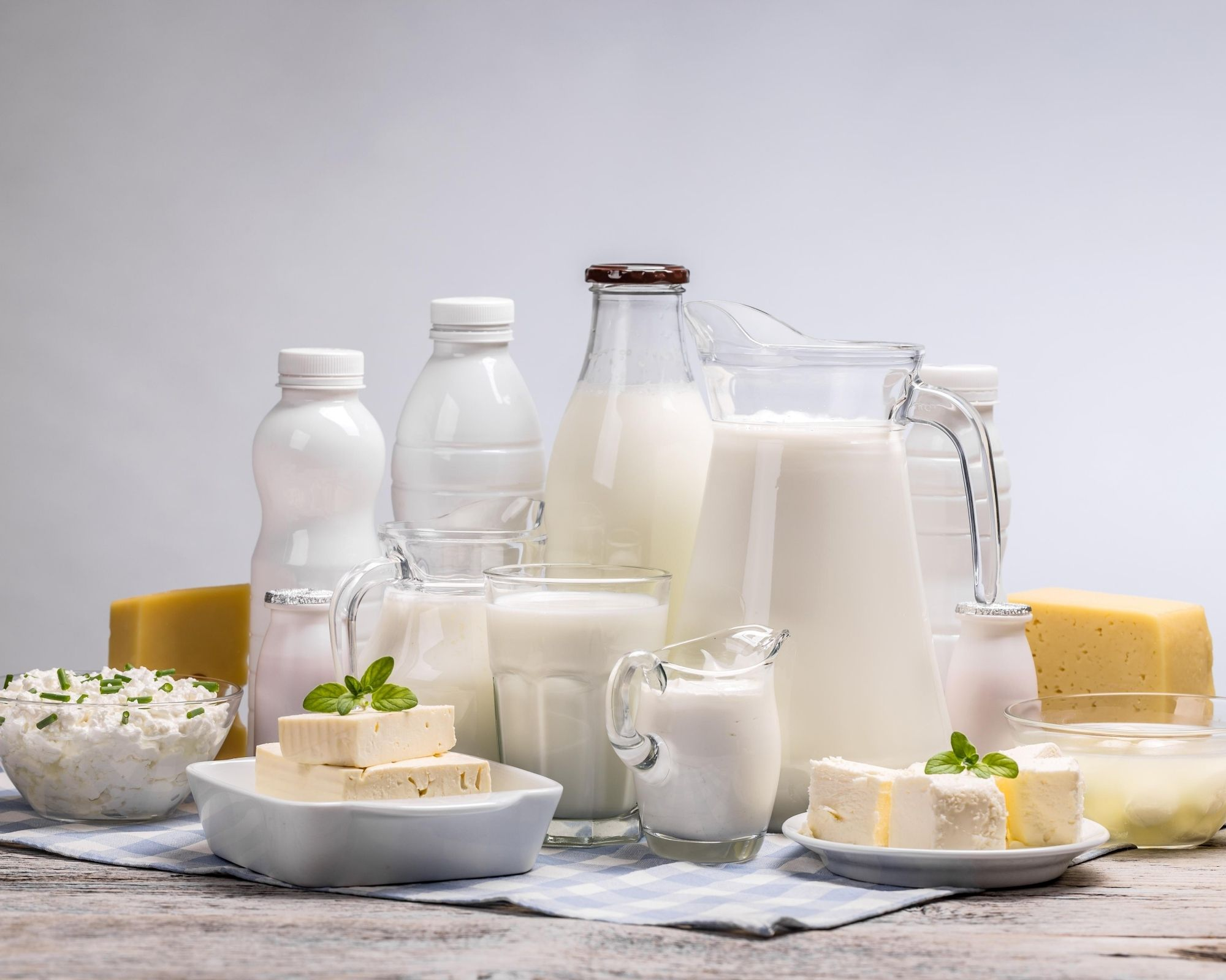 Milk, Cheese, Yogurt, butter on a table.