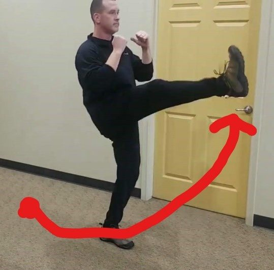 Male positioned with left foot extended in front of him - demonstrating second part of the movement for to strengthen the muscles