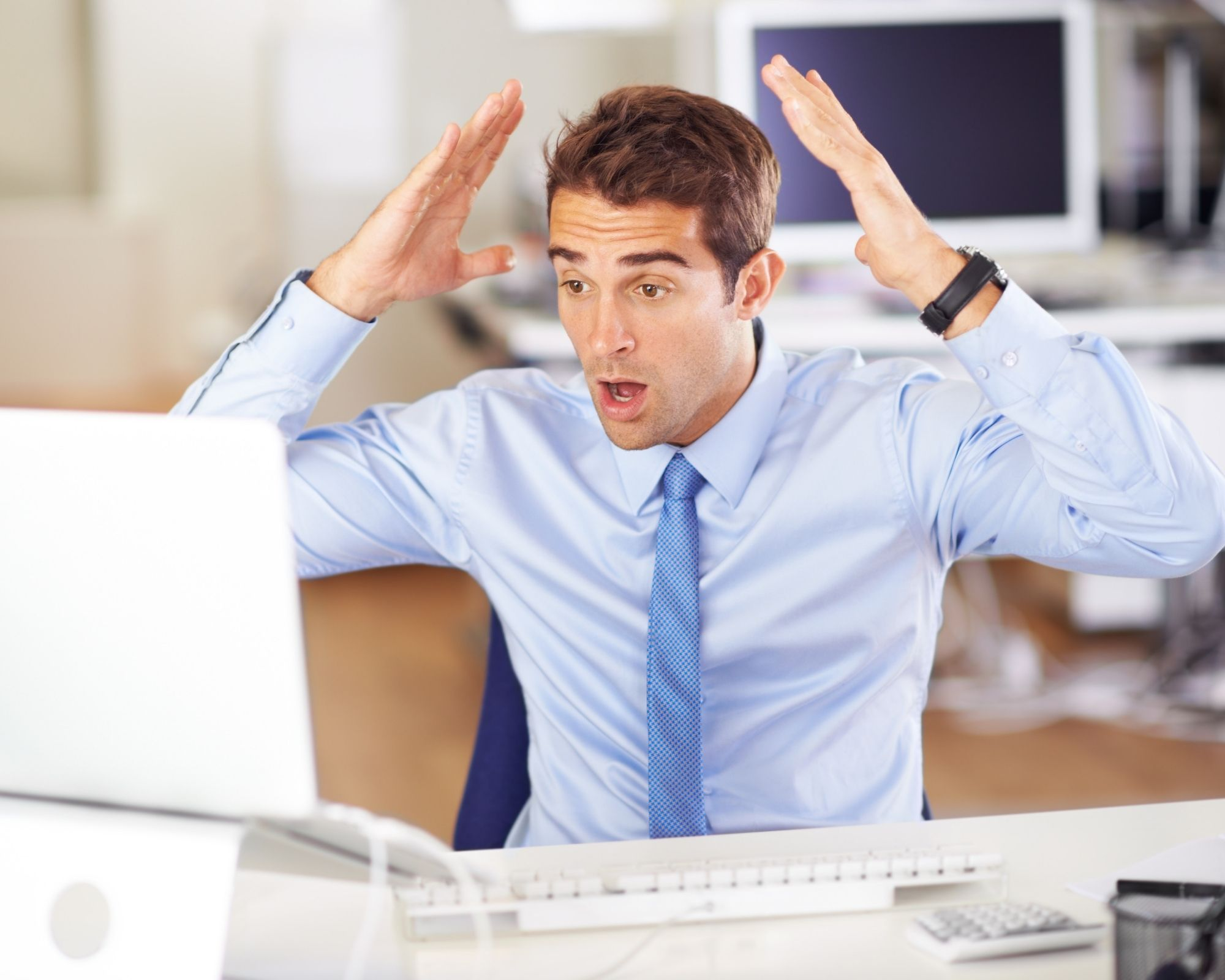 Man at a laptop throwing his hands up in frustration - used to indicate taking care of you is important