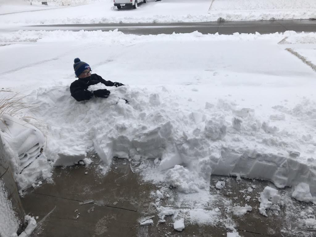 Boy covered in snow - energy