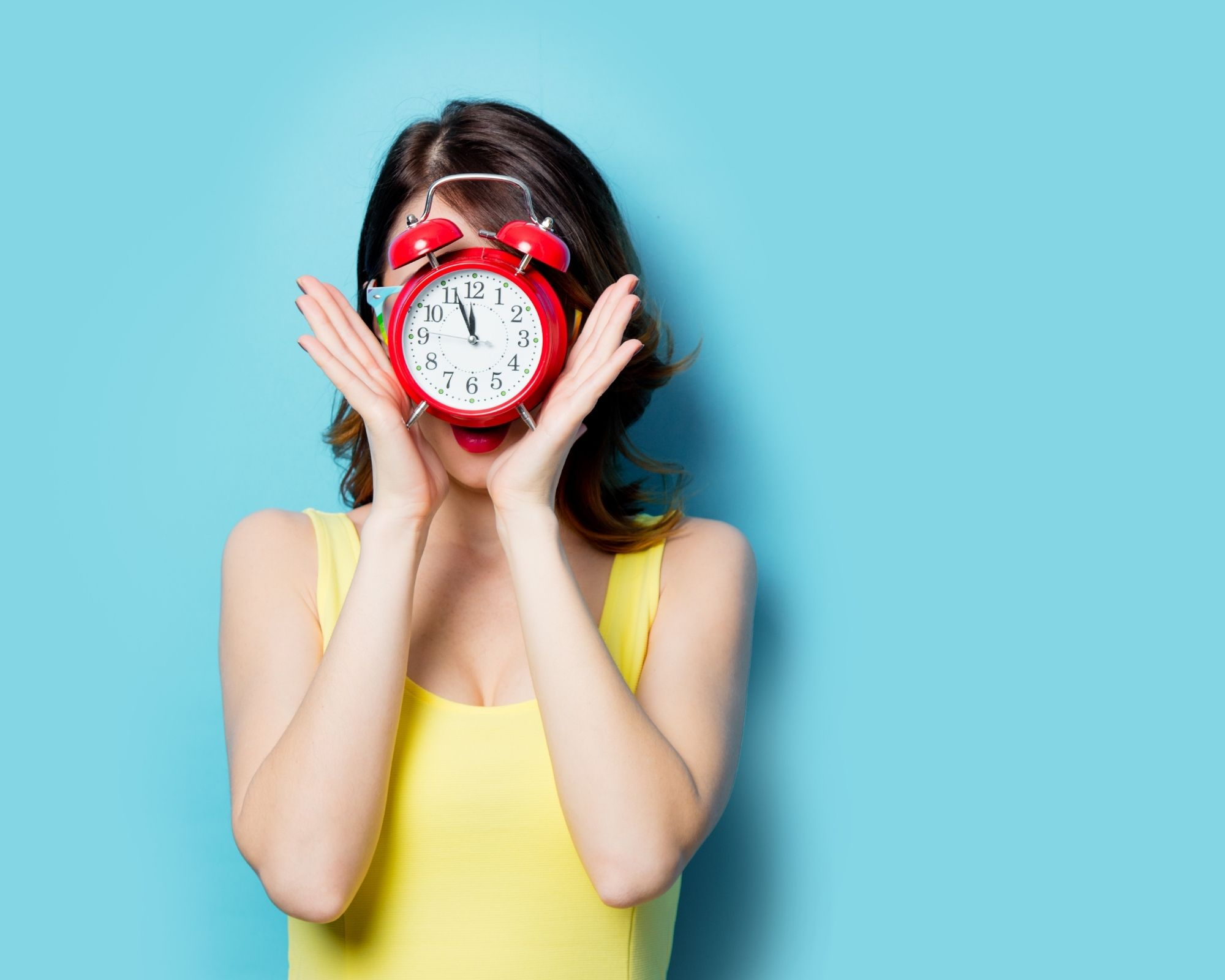 Woman Holding a Clock - Related to timing of eating for weight loss