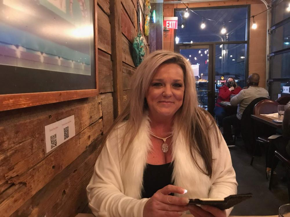 Shawna (woman) sitting in restaurant for date night - intermittent