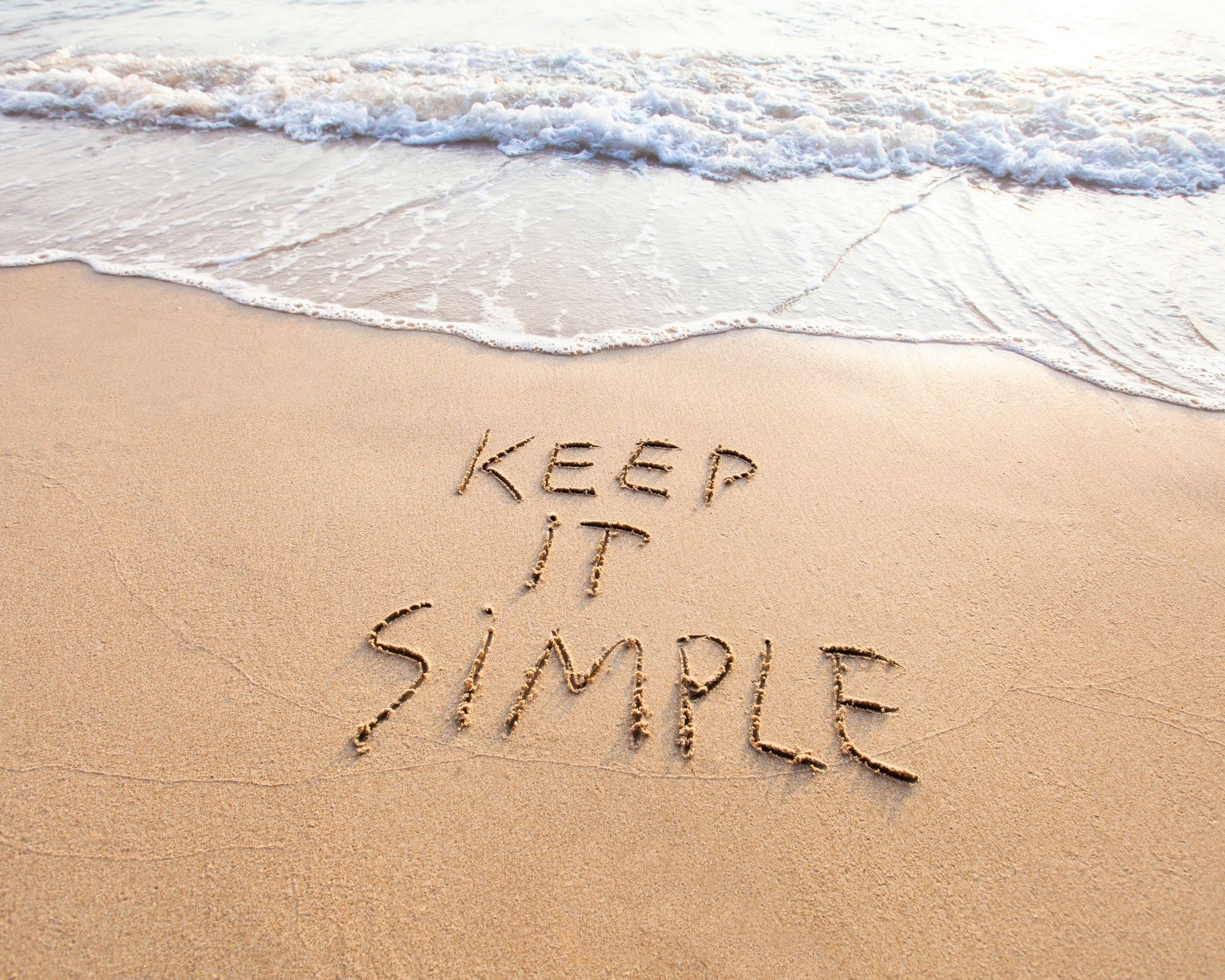 Keep it simple written in the sand