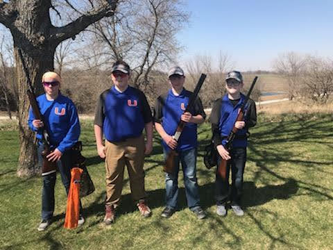 Kids holding their shot guns at the trap shoot competition.