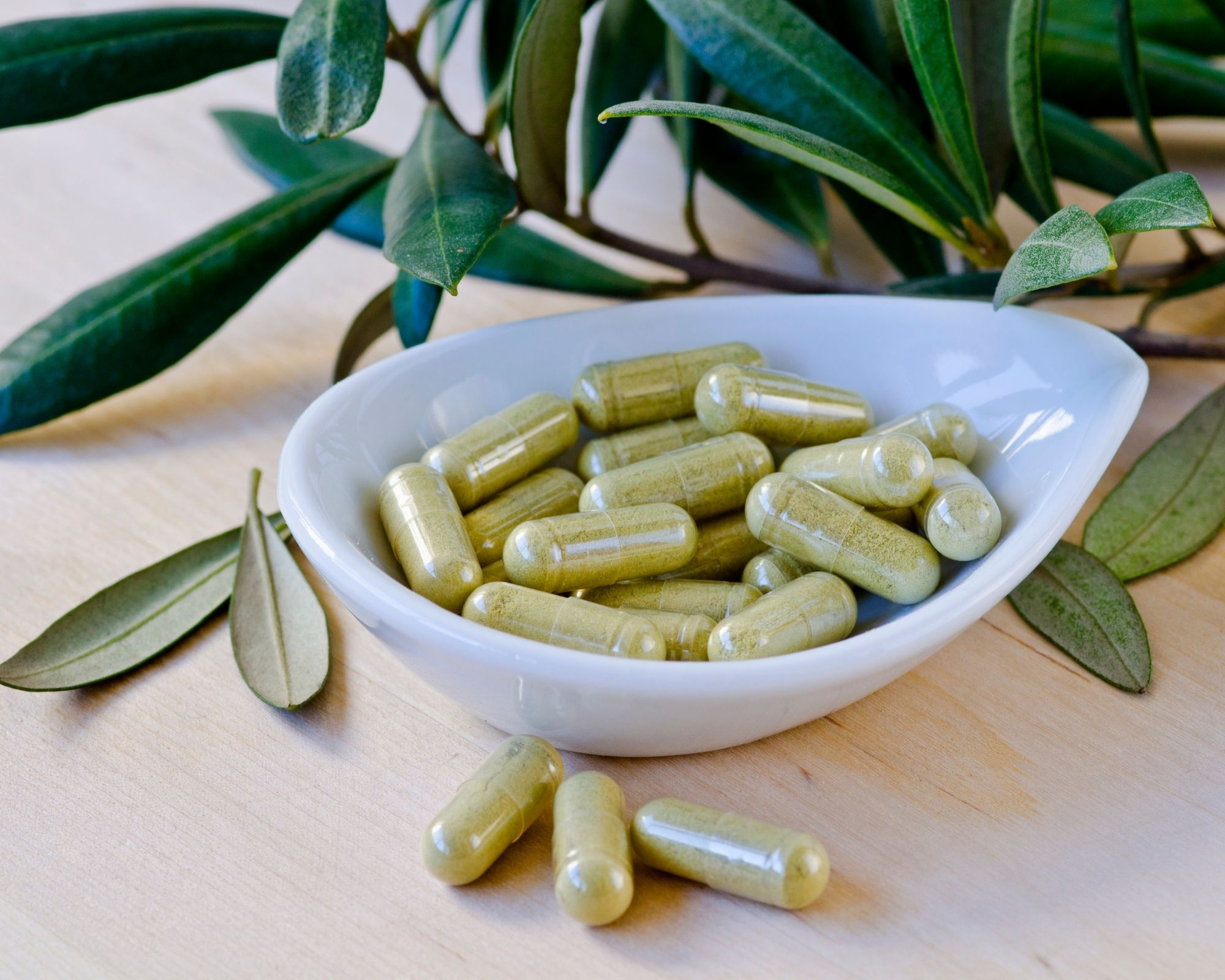 Green pills and leaves in the background - meant to symbolize olive leaf extract pills