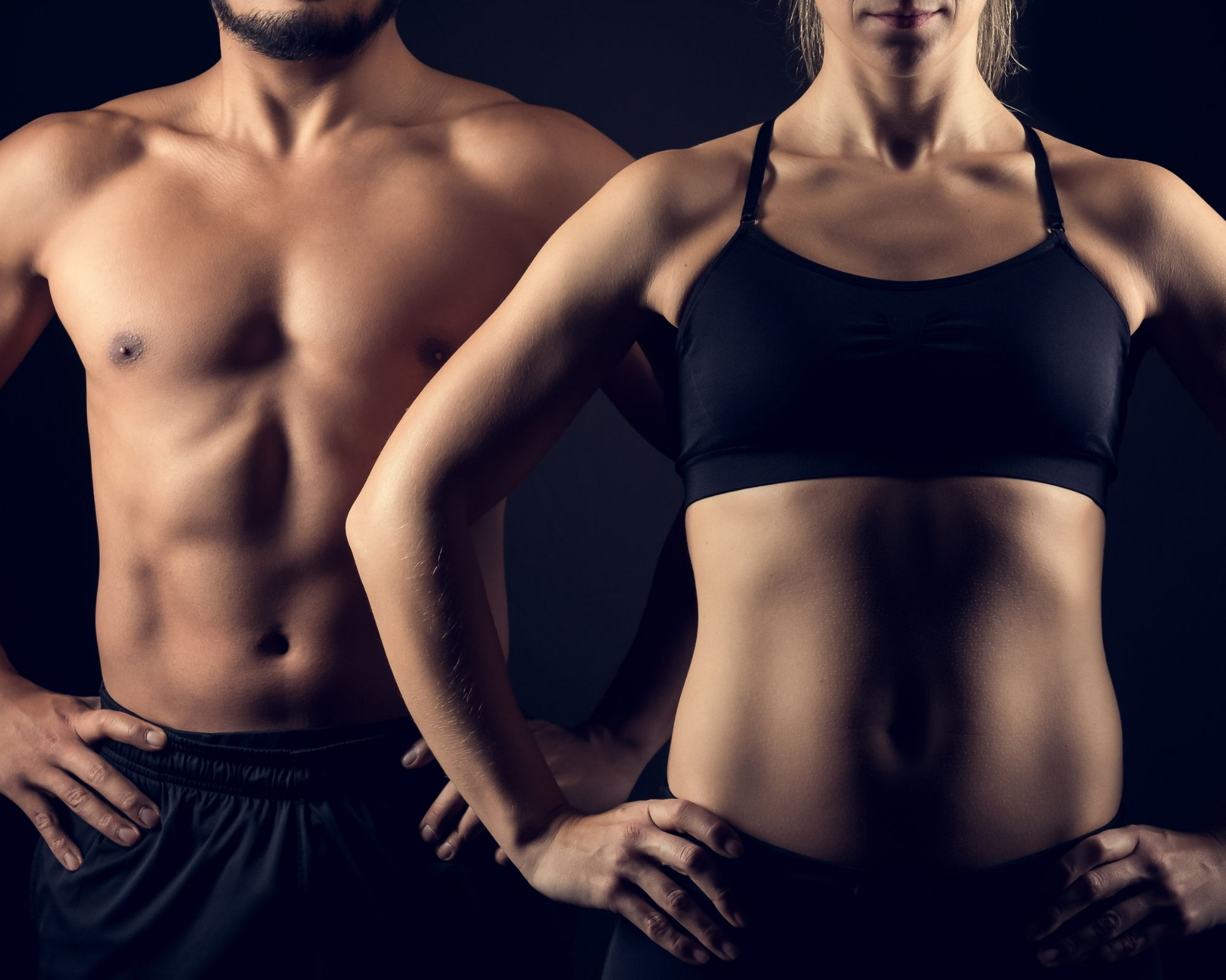 Athletic Male and Female Standing with Hands on Hips - Representing Healthy Joint